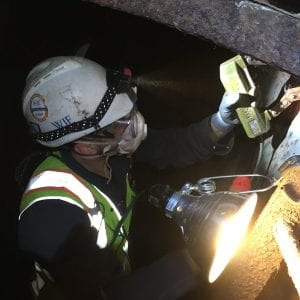 Inspectors examine underneath the westbound JB Bridge this week.