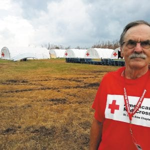 Crestwood resident Jim Bubash traveled to Florida to help victims of Hurricane Irma there. He is pictured in front of a number of white Red Cross tents. He said he found volunteering to be a very rewarding experience.