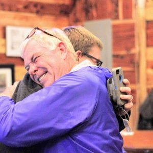 Newly elected state legislator Jim Murphy hugs his son, former Mehlville Board of Education member Jamey Murphy, at his victory party at Cafe Telegraph Tuesday night. Photo by Erin Achenbach.