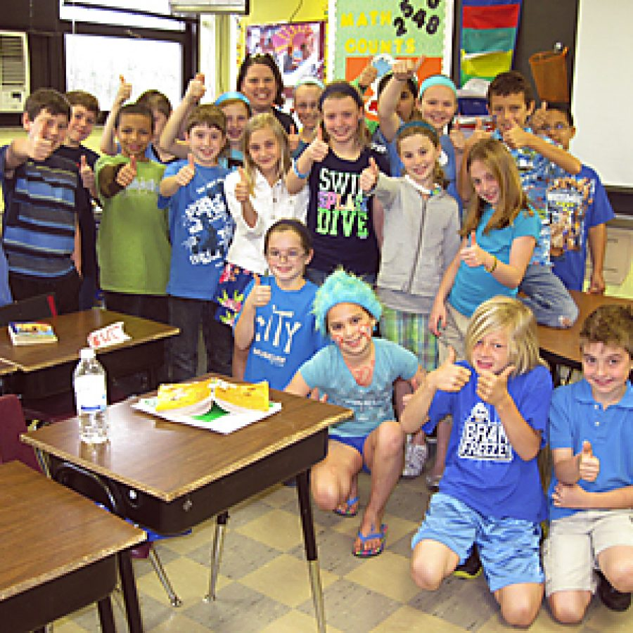 Truman Elementary School students wore blue and donated change in honor of their friend Jacob Swiderski, who is undergoing treatment for a cancerous brain tumor. The \