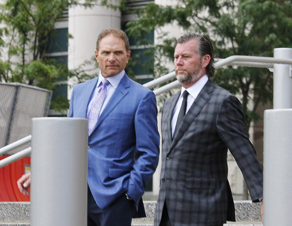 Businessman+John+Rallo%2C+left%2C+walks+out+of+court+a+convicted+felon+after+pleading+guilty+Tuesday%2C+along+with+his+attorney+John+Rogers.+Photo+by+Erin+Achenbach.