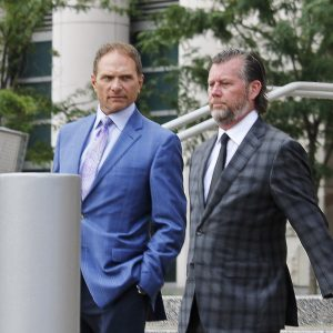 Businessman John Rallo, left, walks out of court a convicted felon after pleading guilty Tuesday, along with his attorney John Rogers. Photo by Erin Achenbach.