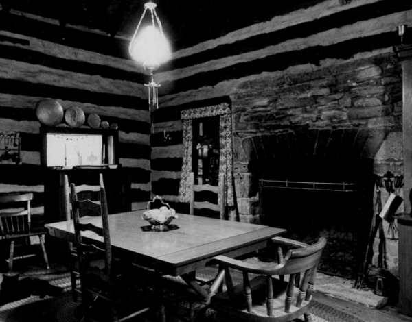 In this black-and-white photo submitted in the 1980s to the National Register of Historic Places, the kitchen is visible through a pass-through.