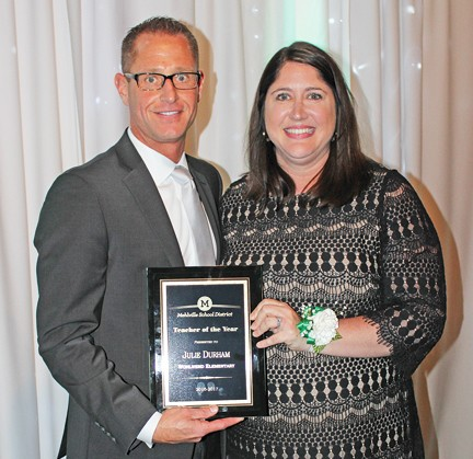 Mehlville School District Teacher of the Year Julie Durham is pictured with Assistant Superintendent Jeff Bresler at the district's annual Recognition Night in 2017.
