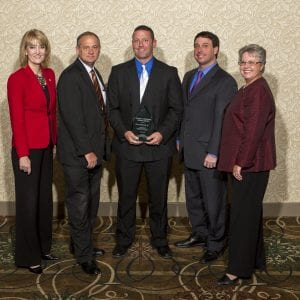 Lemay Chamber Awards - In this Call file photo from 2012, representatives of the Lemay Chamber of Commerce, including, from left, then-St. Louis County Children's Service Fund Director Julie Leicht, Tesson Ferry Committeman John Judd, then-6th District Councilman and current County Executive Steve Stenger, and Rep. Cloria Brown, R-Lemay, present an award to Lemay resident Tom Dittrich Jr.
