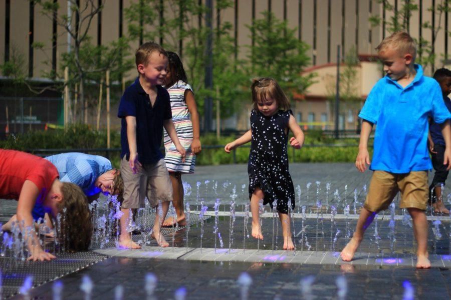 Children play at the Kiener Plaza splash pad.