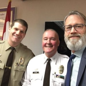 Rockwood Superintendent Eric Knost, right, poses for a selfie with, from left, St. Louis County Police Department Sgt. Shawn McGuire and county police Chief Jon Belmar at the summit between schools and law enforcement in 2018.