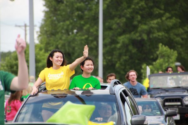 Lindbergh High 2020 graduate Karen Guo waves to spectators during a May 26 car parade for graduates, since an in-person graduation has been postponed due to COVID-19.