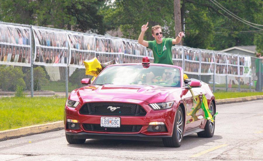 2020 Lindbergh High School graduate Jimmy Keating celebrates graduation with his classmates in a socially distanced car parade on May 26, the original date of graduation.