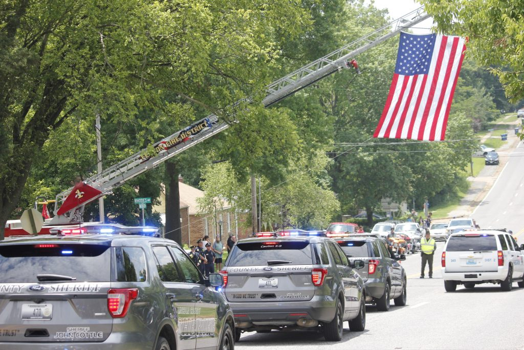 Residents and emergency first-responders from across the St. Louis region came out to pay their respects to North County Police Cooperative officer Michael Langsdorf during his funeral procession from the Cathedral Basilica to Resurrection Cemetery in Affton Monday, July 1, 2019. Langsdorf was fatally shot June 23 while responding to a call about a bad check at a Wellston Food Market.