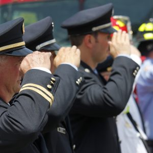 Residents and emergency first-responders from across the St. Louis region came out to pay their respects to North County Police Cooperative officer Michael Langsdorf during his funeral procession from the Cathedral Basilica to Resurrection Cemetery in Affton Monday, July 1. Langsdorf was fatally shot June 23 while responding to a call about a bad check at a Wellston Food Market. Photo by Erin Achenbach.