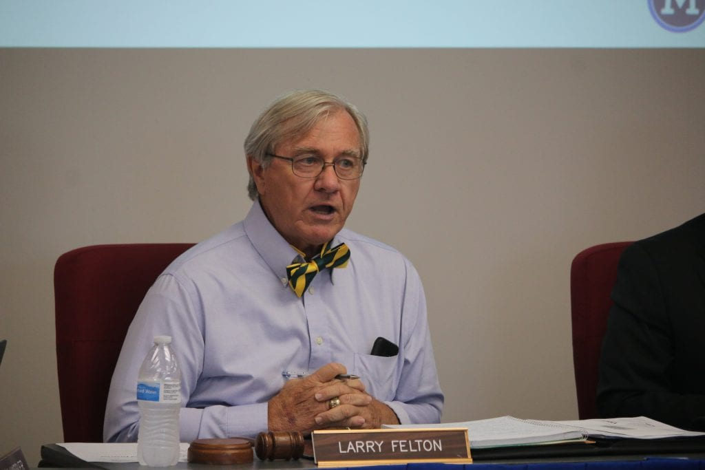 Larry+Felton+speaks+at+2018+meeting+while+wearing+a+bowtie.