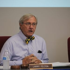 Larry Felton speaks at 2018 meeting while wearing a bowtie.