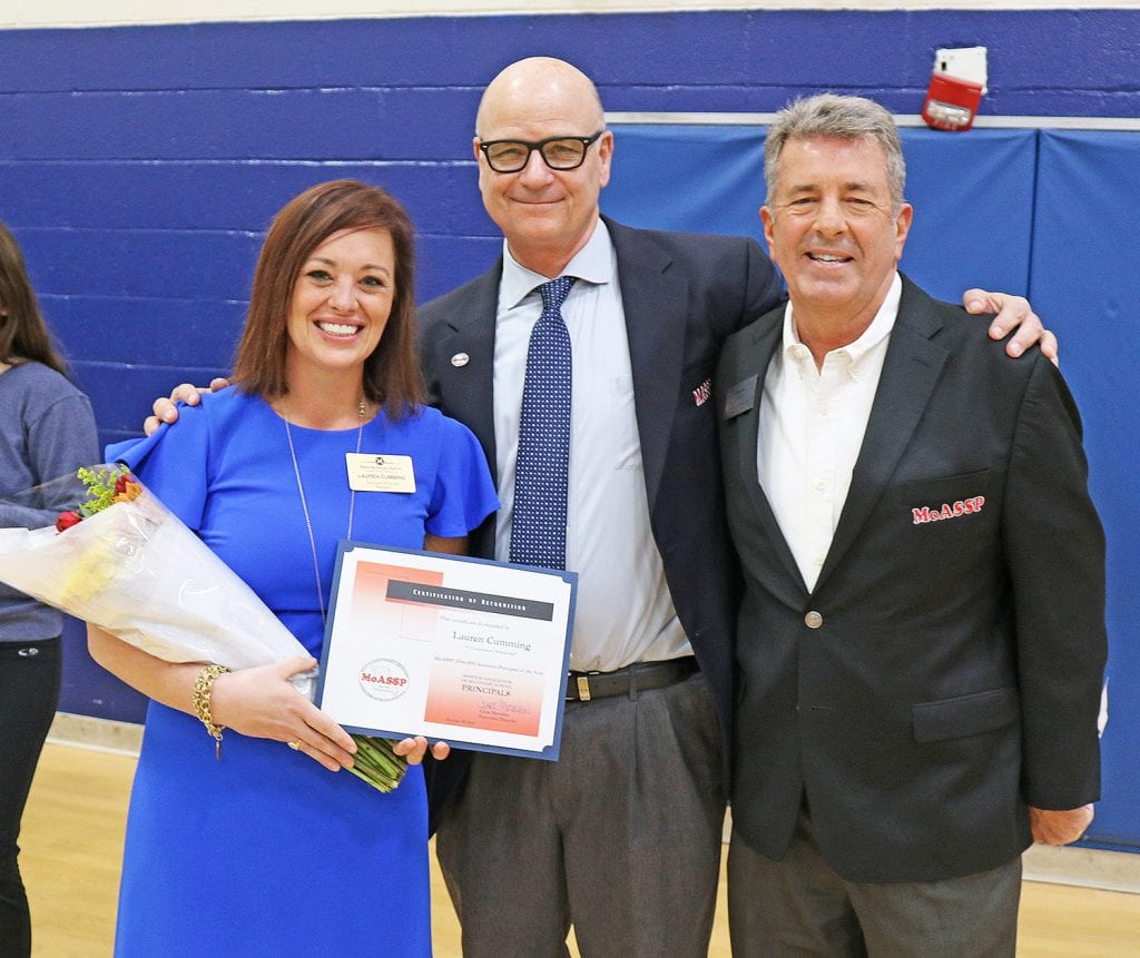 Above from left, Bernard Assistant Principal Lauren Cumming accepts her award last week from Ed Gettemeier, president of Missouri Association of Secondary School Principals and principal of Hardin Middle in St. Charles; and Clark Mershon, executive director of Missouri Association of Secondary School Principals.