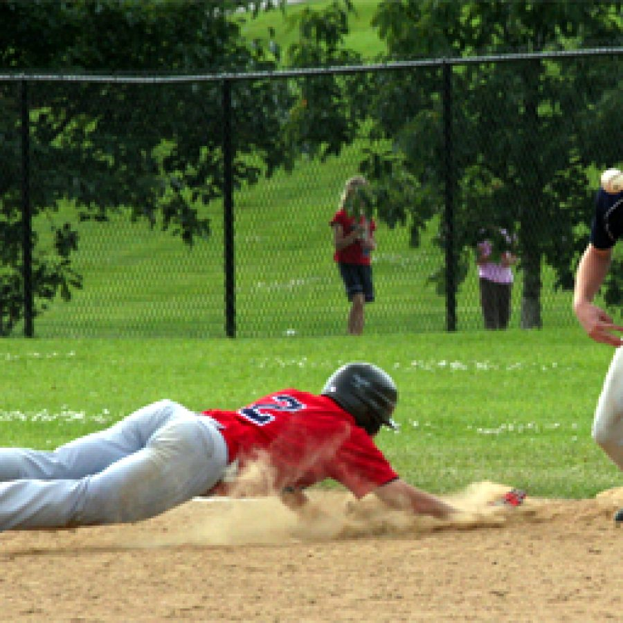 Oakville's Alex Roedner slides head first toward first base to avoid being picked off in Sunday's 15-12 loss to Maryland Heights.