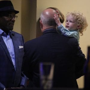 In this photo taken at County Executive Steve Stenger's victory party in Sunset Hills in August, Stenger's son Lincoln touches the head of Chief of Staff Bill Miller, who resigned last week. Photo by Jessica Belle Kramer.