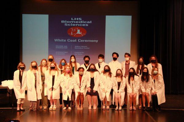 Graduates with their whitecoats