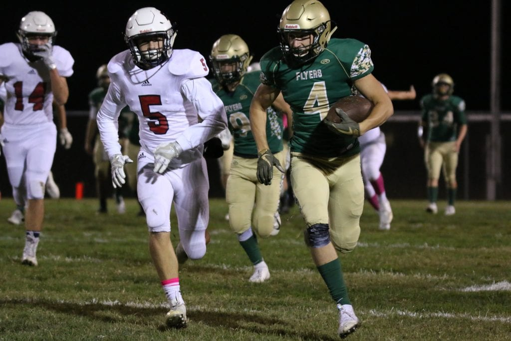 Lindbergh football senior Nick Roth, right, carries the ball during a Flyers' victory against Parkway South during the 2018 football season at Lindbergh. The Flyers topped the Patriots 43-12 on Lindbergh's 2018 senior night, as  senior football players, band members, Flyerettes and cheerleaders were honored for their four years of Friday night contributions.