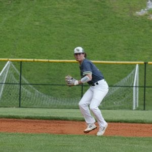 Aaron Moss (13) is safe at third base on this play Friday in an away game against St. Mary's. St. Mary's infielder Steven Russo (2) waits on a throw from the outfield. Photo by Bill Milligan.