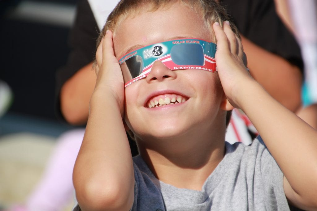 A student at Lindbergh's Dressel Elementary School looking through pinhole viewers, and witnessing the eclipse using the special eclipse glasses that were issued to each student.