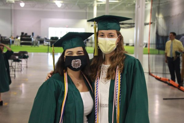 Members of the Lindbergh High School Class of 2020 graduate in masks at an outdoor drive-in graduation at the PowerPlex in Hazelwood in June 2020.