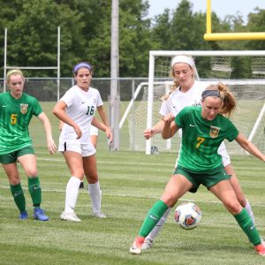 Lindbergh forward Erin Clancy, a senior, receives the ball and prepares to evade Nerinx midfielder Allison Brown, junior, during the state quarterfinals May 25 at Lindbergh. Photo by Jessica Belle Kramer.