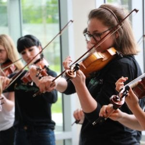 Strolling Strings music trivia helps pay for trip