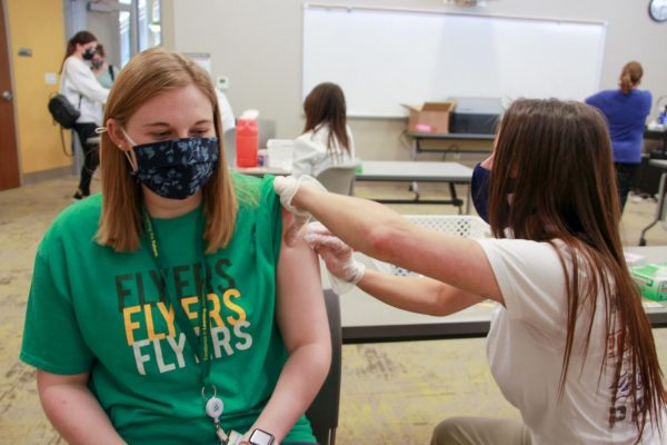 A Lindbergh teacher receives a COVID-19 vaccine at the March 30 clinic.