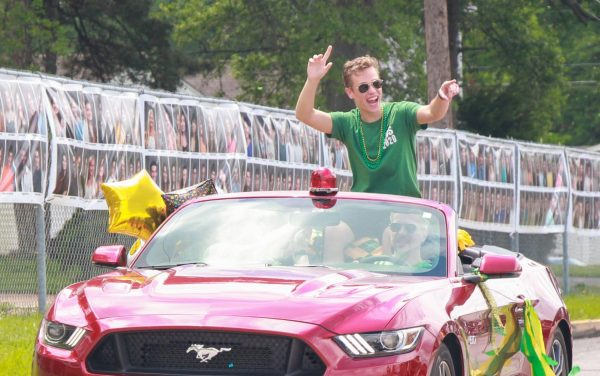 Lindbergh High School 2020 graduate Jimmy Keating celebrates graduation with his classmates in a socially distanced car parade May 26, the original date of graduation.