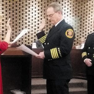 Crestwood Assistant Fire Chief Lou Hecht, center, takes the oath of office during a city meeting in May 2017. Deputy City Clerk Theresa Pfyl administered the oath to Hecht, who previously served as deputy chief with the Fenton Fire Protection District. Also pictured is former Fire Chief David Oliveri.