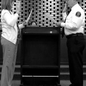 City clerk Helen Ingold administers the oath to new Fire Chief Lou Hecht at the Crestwood Board of Aldermen meeting Nov. 13. Hecht is taking over the role of fire chief after former Chief David Oliveri moved to Washington state to become fire chief of the town of Anacortes. Photo by Erin Achenbach.