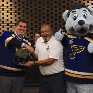 The Crestwood Board of Aldermen meeting had some special guests last week, as the city presented St. Louis Blues mascot Louie and Bob Plager, one of the franchise's first players, with a proclamation honoring the Blues and their Stanley Cupwinning season. 'The whole city of Crestwood was pulling for you, the whole St. Louis region was pulling for you,' said Mayor Grant Mabie, above left, as he presented Louie and Plager with a copy of the proclamation at the Aug. 27 meeting. Photo by Erin Achenbach. For more photos and an article, see Page 2A.