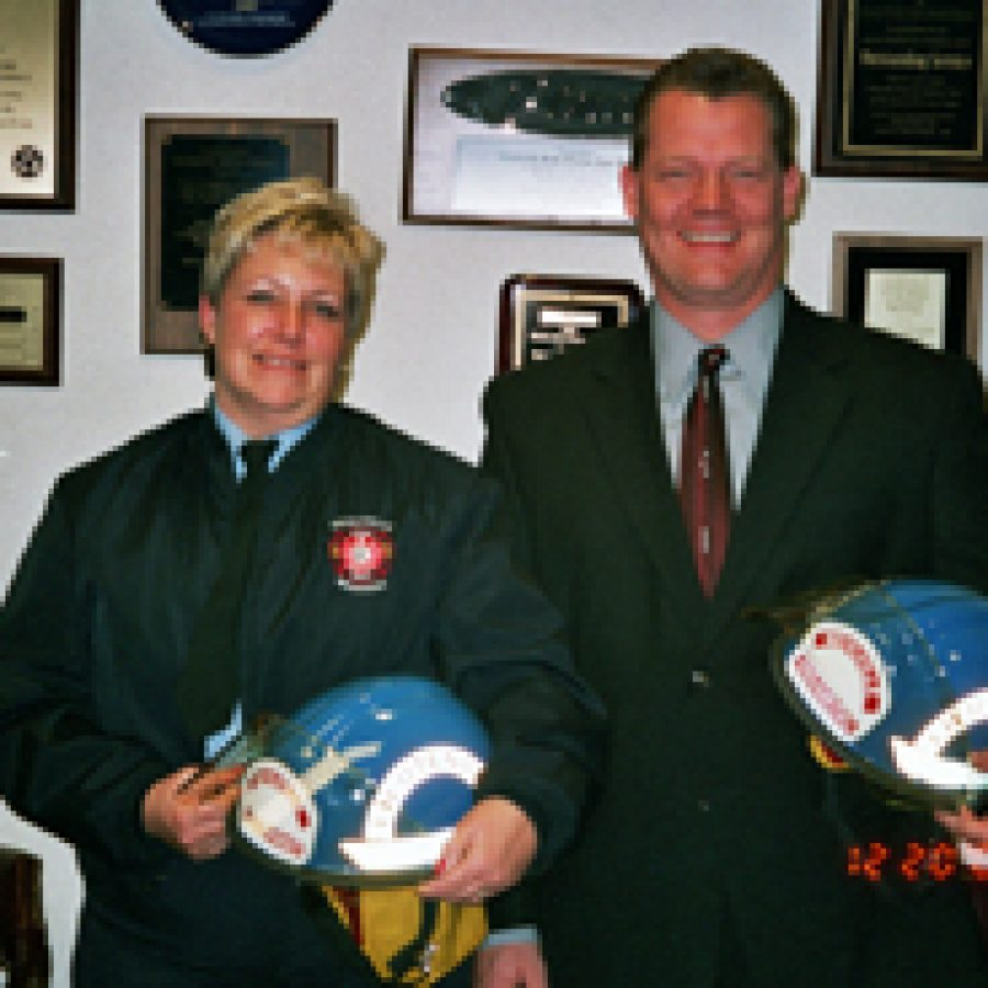 Mehlville Fire Protection District paramedics Nancy Gartner, left, and Doug Weck recently were promoted to lieutenant.