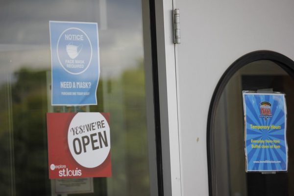 A sign on the front door of Incredible Pizza Company in South County Aug. 4  advises customers that they must wear a mask when inside the building at all times, except when eating or drinking.