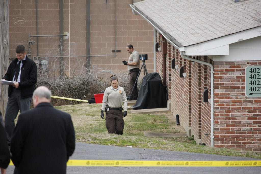 Pictured above: Police investigate the scene of an officer-involved shooting at an apartment complex off Nottingham Estates Drive in South County on March 19. The suspect who was shot by police was taken to the hospital with serious injuries. Photo by Erin Achenbach.