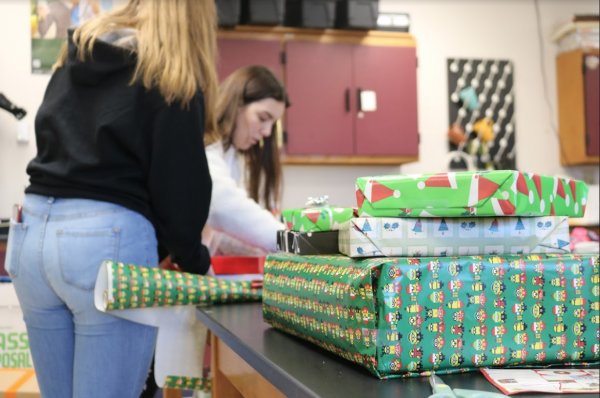 MHS students wrap hundreds of shoeboxes filled with toys, clothes and household necessities to donate to families in need in Mehlville School District and a nearby district.
