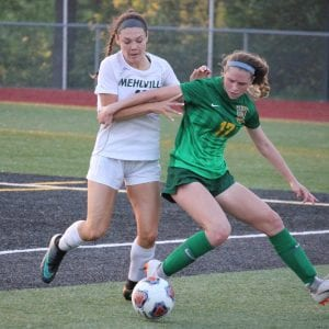 Lindbergh junior Maura Haegele, right, defends the ball from Mehlville sophomore Kailee Wisber in the district championship game May 15. Photo by Erin Achenbach