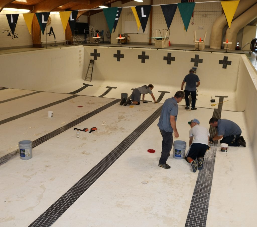 Workers make repairs and repaint the Mehlville School District pool. Photo courtesy of the Mehlville School District.