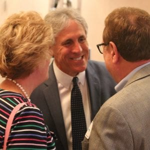 Mark Mantovani talks with Amy Stuber of Creve Coeur and John Snodgrass of Richmond Heights at his watch party in August 2018 after absentee results came in. Photo by Jessica Belle Kramer.