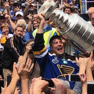 Former St. Louis Blues left wing and South County native Pat Maroon celebrates with fans along the Stanley Cup Parade route in downtown St. Louis Saturday, June 15, 2019. Photo by Erin Achenbach.
