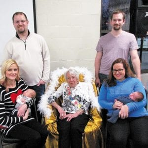 To celebrate Mary Halliburton's 100th birthday, she posed with two of South County Baptist Church's babies born this year, 100 years after her. Pictured, from left, are: A.J. Hof with parents Keri and Adam Hof; Halliburton; and Jensen Leslie with parents Alexandra and Bradley Leslie.