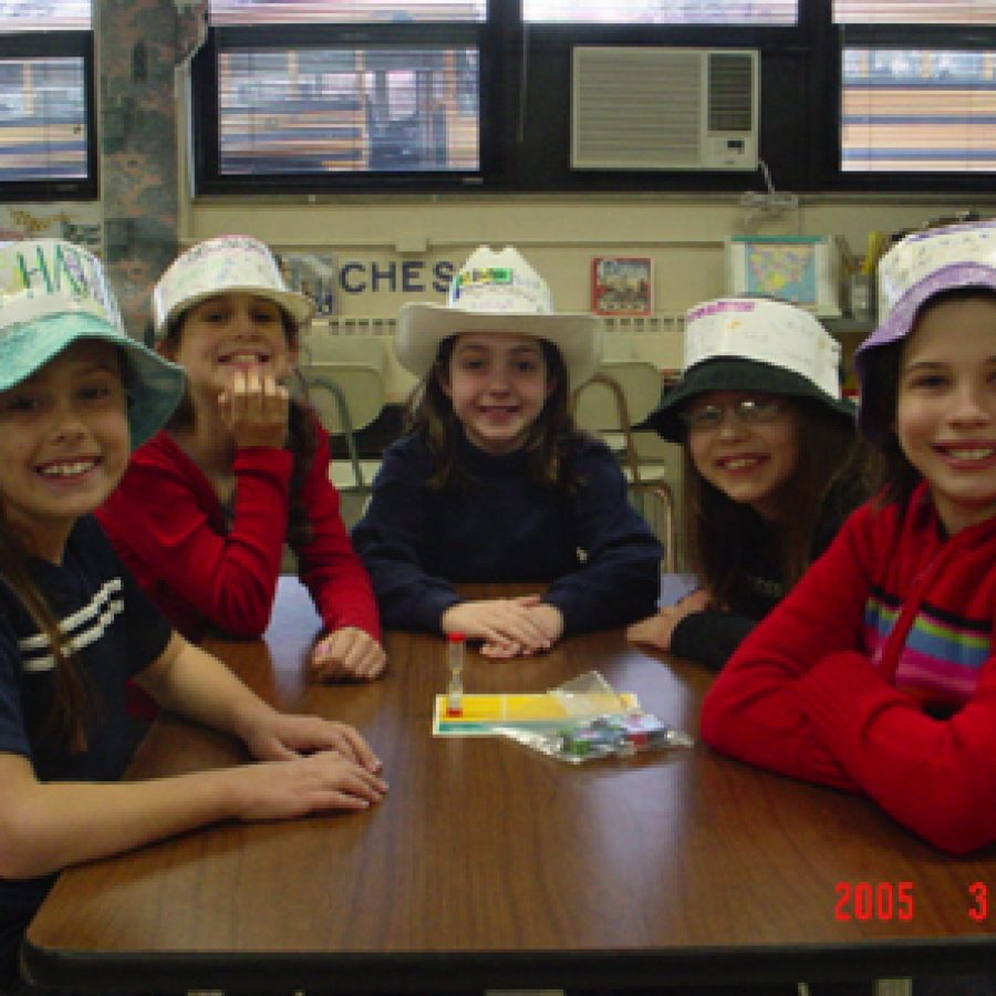 Sporting their award-winning hats are 'The Math Hatters\