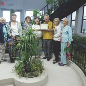 The Mehlville Garden Club issues a beautification citation to First Unity Church in Concord. Photo by Bill Milligan.