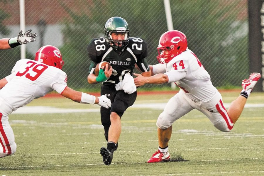 Mehlville High's Mike Mik, center, is pursued by Chaminade's Brennan Drury, left, and Chaminade's Luke Hanley in Friday night's season opener, Aug. 22, 2014.