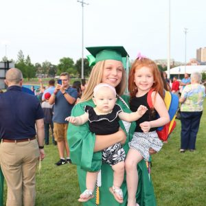 Mehlville class of 2019 graduate Sydney Gruber with her family after the ceremony.