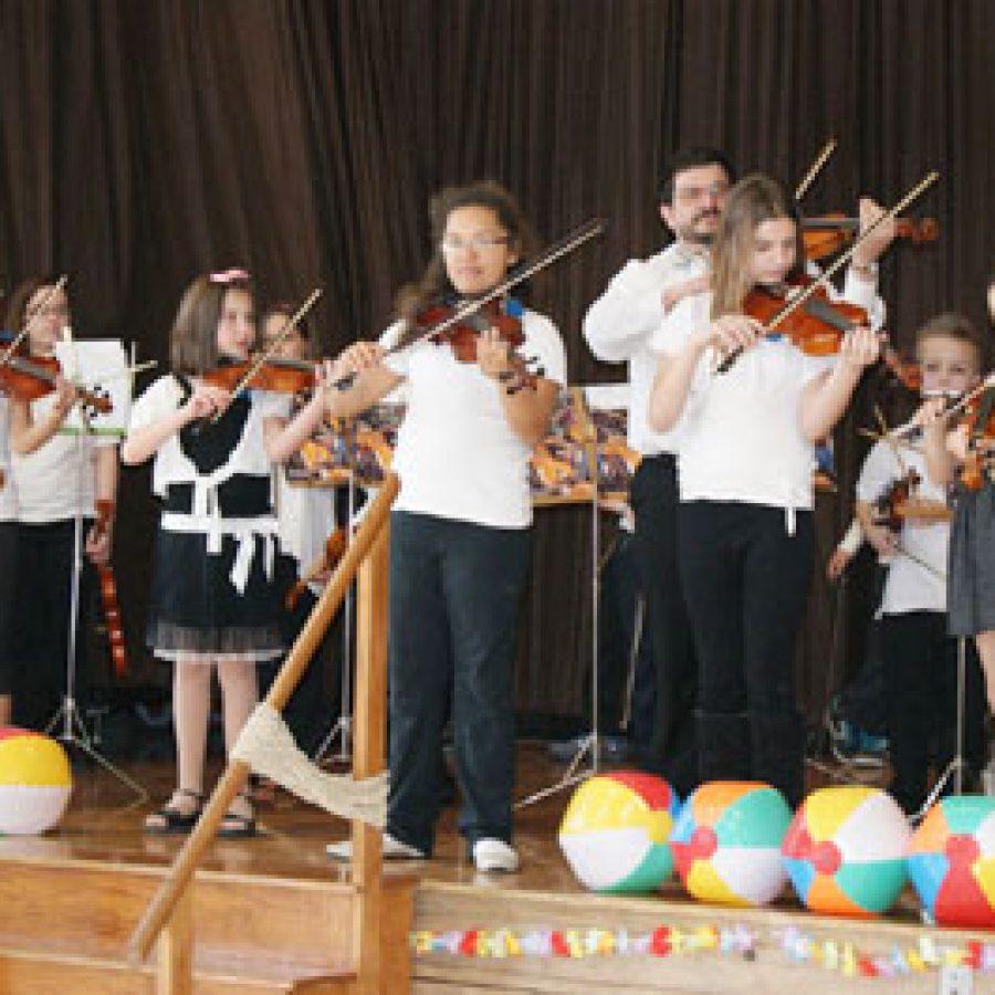 Bierbaum Elementary School strings students perform for nearly 120 60plus Club members at Bierbaum's Beach Bash.