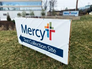 A sign points to the Mercy drive-thru testing site in Chesterfield. Mercy has also opened two sites in Jefferson County.