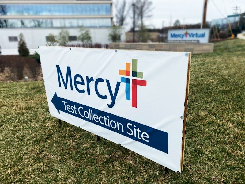 A+sign+points+to+the+Mercy+drive-thru+testing+site+in+Chesterfield.+Mercy+has+also+opened+two+sites+in+Jefferson+County.+
