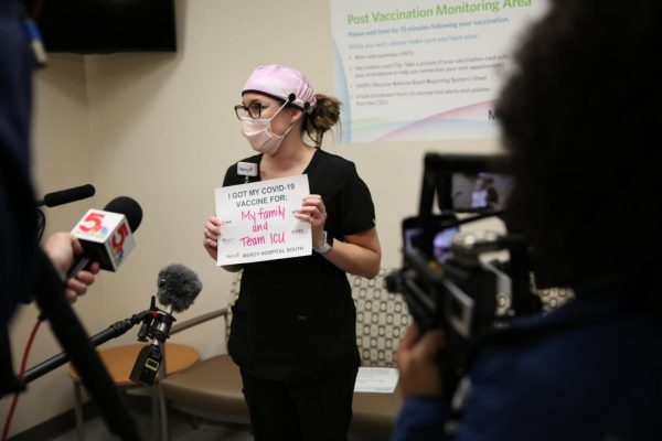 Intensive care nurse Nicole Boyer speaks with reporters after being one of the first 20 nurses at Mercy Hospital South to receive the COVID-19 vaccine Monday, Dec. 14, 2020. Boyer, who works in the ICU, has seen
