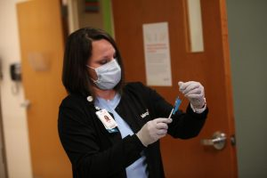 A nurse at Mercy Hospital South prepares the first dose of Pfizer/BioNTech's COVID-19 vaccine for Mercy's Chief Medical officer Aamina Akhtar Monday, Dec. 14, 2020. Mercy South planned to vaccinate 20 nurses on Dec. 14 and another 20 nurses on Dec. 15.